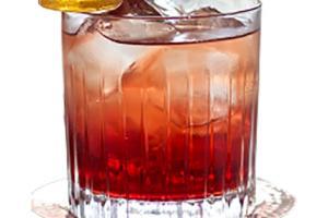 Hot Peach Rhapsody Cocktail med slikkepind